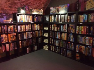 a two walls of bookshelves filled with boardgames